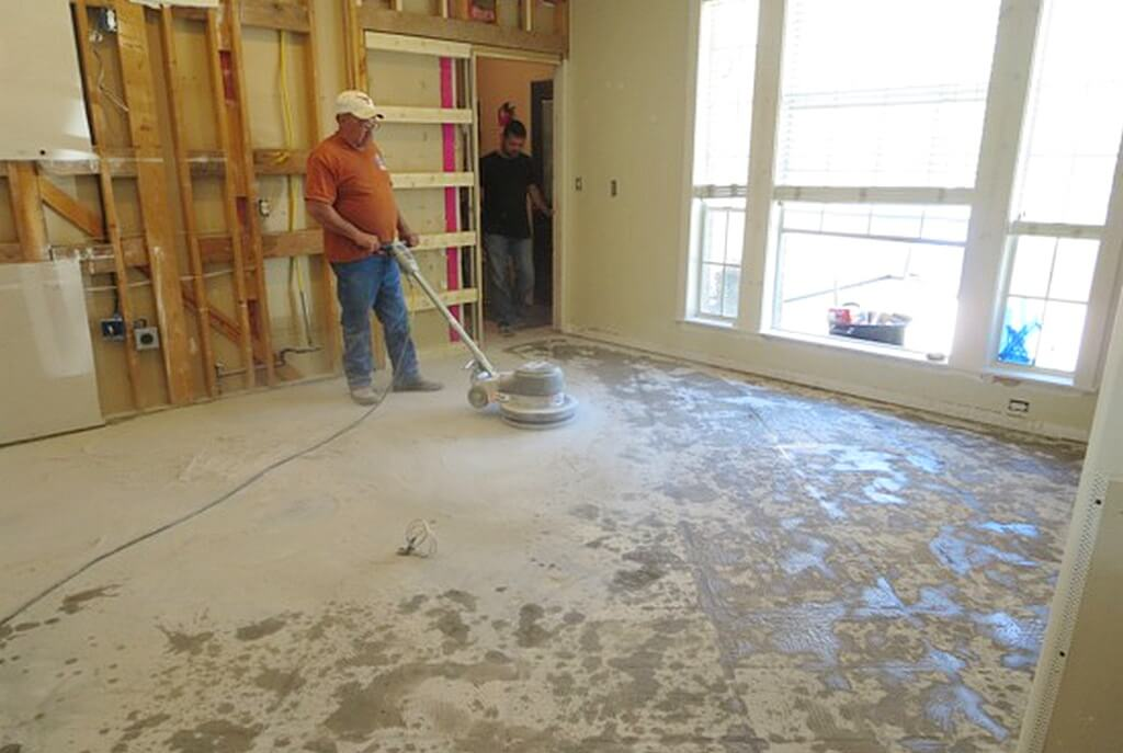 Removing tile from cement floor